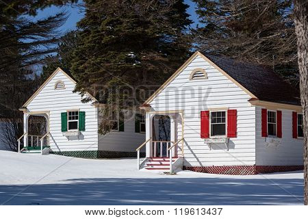 Tiny cottages in the snow.