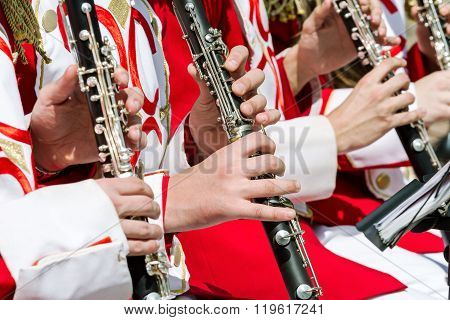 Young Musicians Playing Clarinet In Street Orchestra