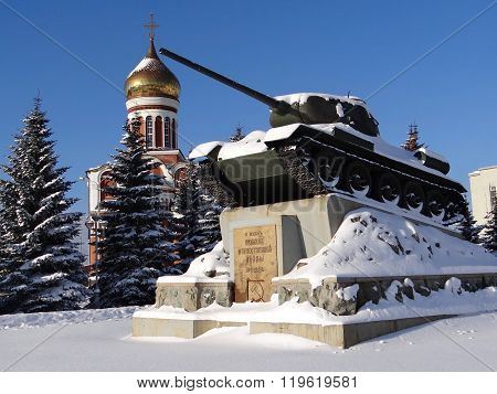 NIZHNY TAGIL, RUSSIA - OCTOBER 21, 2014: Photo of T-34 tank and the Temple of Dmitry Donskoy.