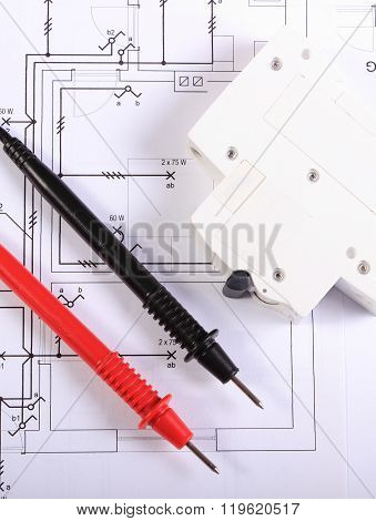 Cables Of Multimeter And Electric Fuse On Construction Drawing