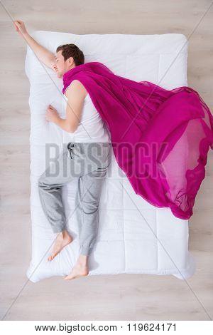 Nice man sleeping in  bed