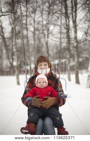 Mother And Daughter On Swings