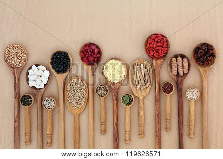 Superfood for good health in wooden spoons forming an abstract background with copy space. High in antioxidants, vitamins and minerals.