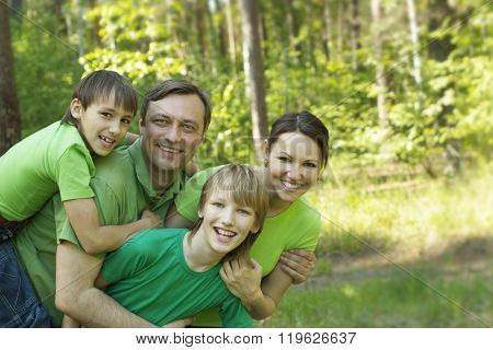 family in the summer park