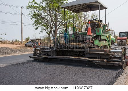 asphalt concrete on paver machine in the road