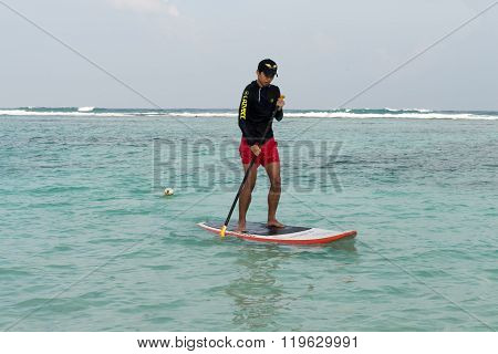 Man Paddling On Stand Up Paddle Board