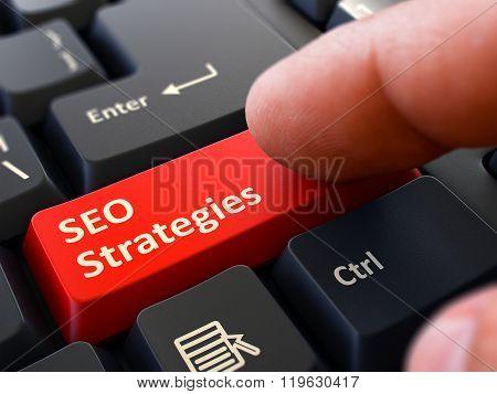 SEO Strategies - Written on Red Keyboard Key.