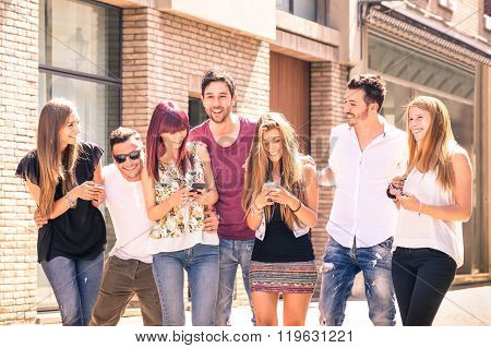 Group Of Young Best Friends Having Fun Together Walking On Town Street - Connected Community