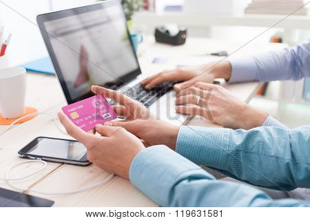 Married Couple Shopping Online At Home