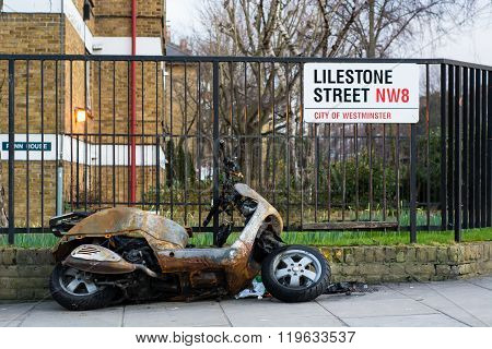 Burnt Out Moped In Central London