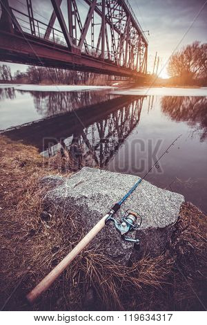 Fishing rod by the river.