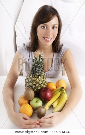 Young Woman With Fruit