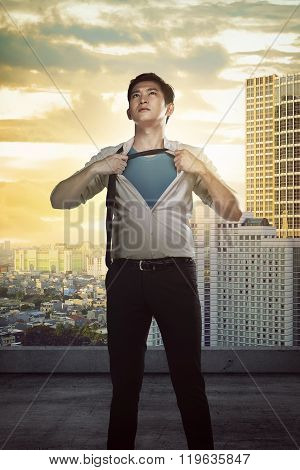 Asian Business Man Showing A Superhero Suit