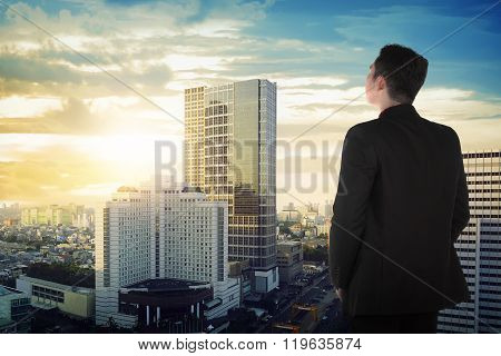 Back View Of Asian Business Man Looking The Sky