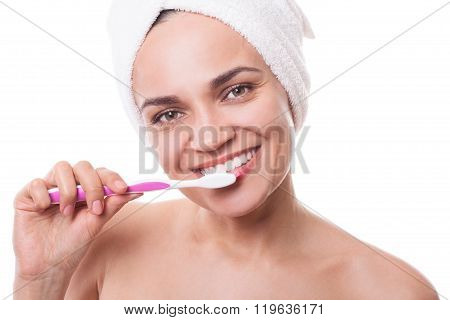 Girl In Towels Brushing Teeth After Bath In Morning Evening