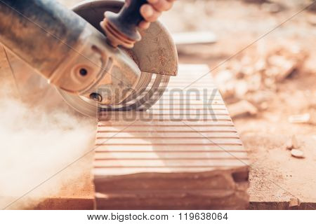 Construction Details - Close-up Of Angle Grinder Cutting Through Bricks
