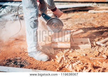 Industrial Construction Worker Using A Professional Angle Grinder