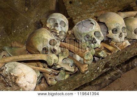 Skulls And Cigarettes In Tampangallo Burial Cave At Tana Toraja. Indonesia