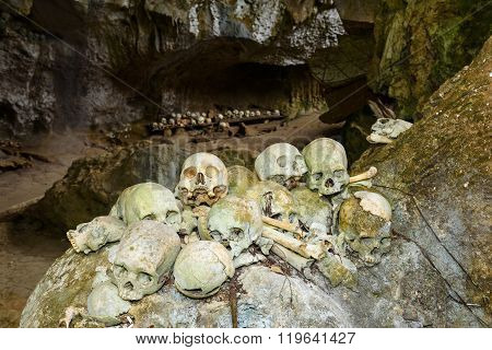 Pile Of Skulls By The Entrance To Tampangallo Burial Cave In Tana Toraja. Indonesia