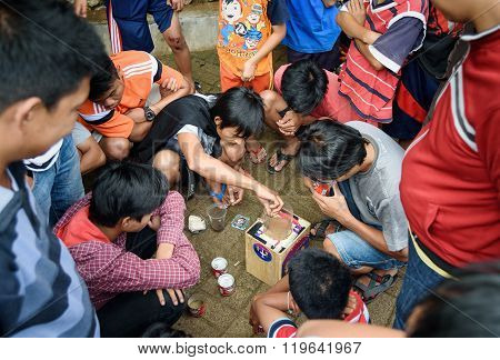 Indonesian Boys Spend The Cricket Fighting In The Street