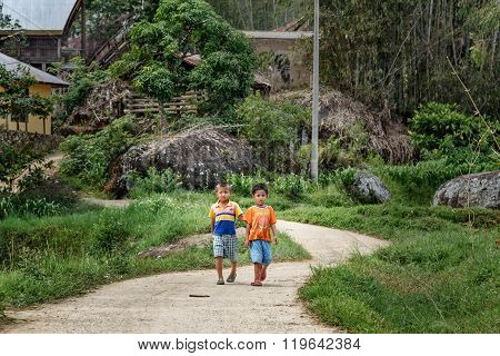 Two Indonesian Boys On The Road In Tana Toraja