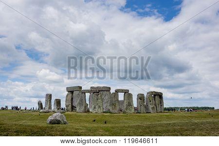 Stonehenge with many tourists.