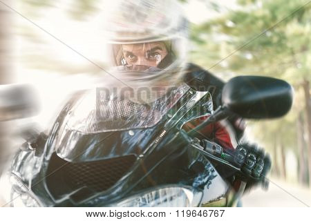 Biker On The Road Riding Fast