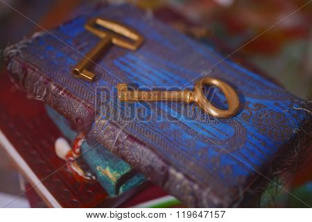 Old gold keys and notepads close up