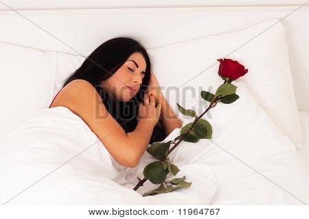 A Beautiful Young Girl Lying In Bed With Gifts, Roses, Woke Up, Asleep.