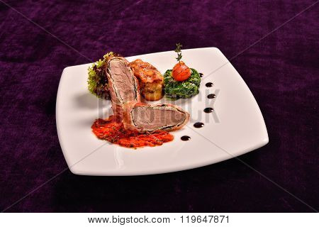 Pork Tenderloin In Bacon Wrap With Tomato Sauce Flavored With Rosemary And Potatoes Stuffed With Pan