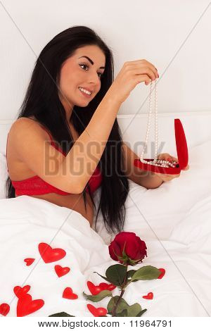 In Love With A Beautiful Young Girl Lying In Bed With Gifts, Cards, Hearts, Roses. Feast Day Of St.