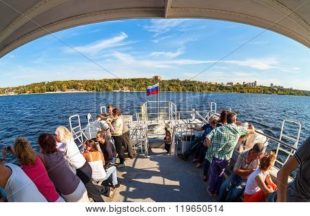 Tourists At The Excursion Boat Traveling By The Volga River In A Sunny Summer Day
