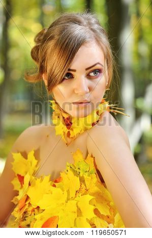 Portrait Of A Beautiful Young Woman In Autumn Leaves