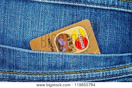 Credit Card Mastercard Sticking Out Of The Back Jeans Pocket