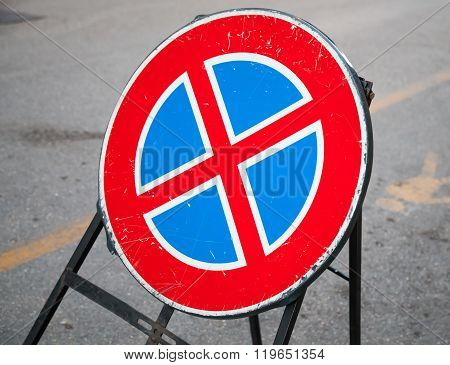 Round Road Sign Stands On Urban Roadside