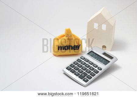 House, money, and calculator