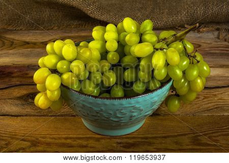 White Grapes On Dark Wooden Background