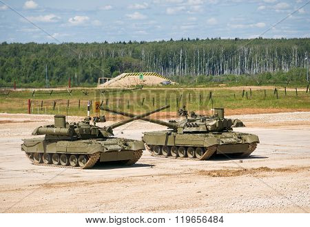Two tanks T-80 crossed guns