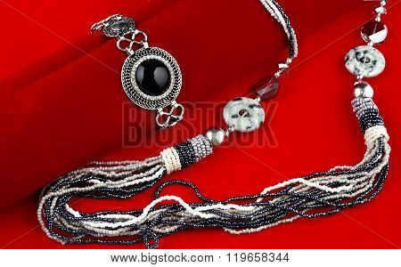 Fabulous black and white fashion jewelry on red velvet