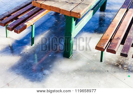 Outdoor Table And Benches Frozen In Puddle