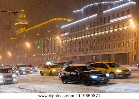 Street Traffic Under Snow In Night City