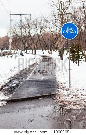 Wet Bicycle Path In City In Bad Weather