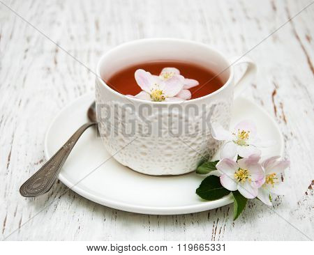 Cup Of Tea And Spring Apple Blossom