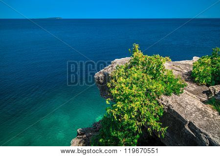 View of cliff hanging above gorgeous Huron lake at bruse Peninsula, Ontario