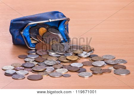 Purse And Coins On The Table