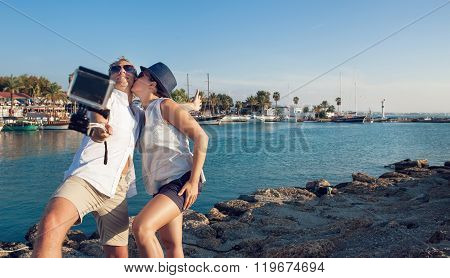 Young Couple Take Their Kissing Self Photo
