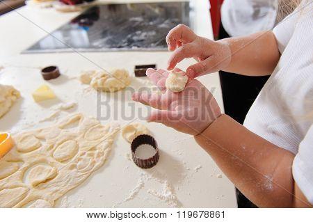 Hands Of  Child Knead Dough