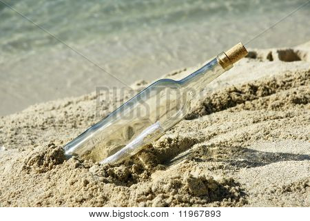 Message in a bottle on an isolated beach