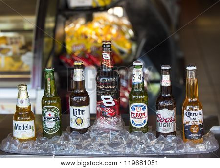 Key West, Florida, USA - January 09, 2016: Popular seven bottles of assorted cold beers in ice including Modelo, Heineken, Lite Budweiser, Peroni, Coors Light and Corona Extra horizontal picture.