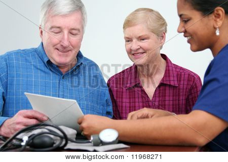 Man having his blood pressure checked by a nurse